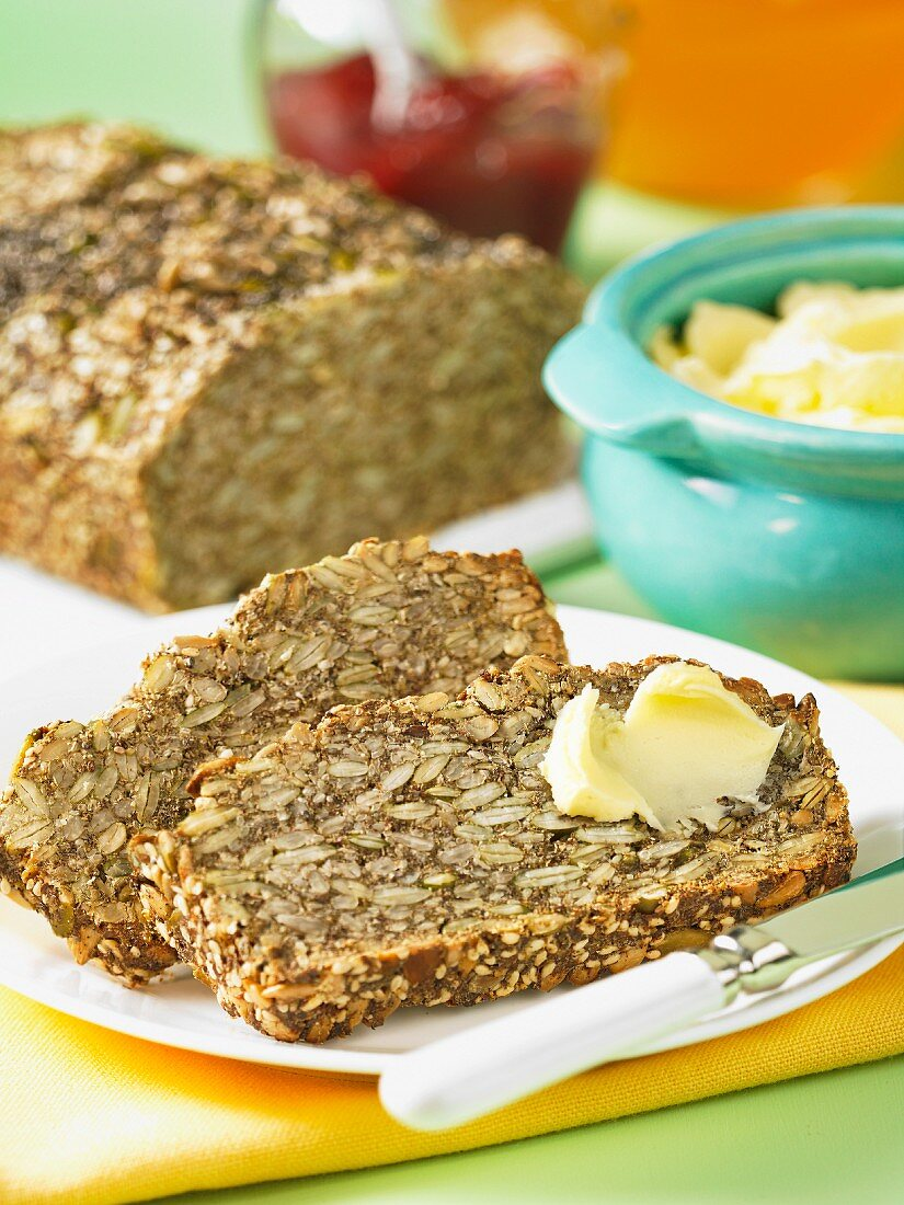 Seeded bread with butter and jam