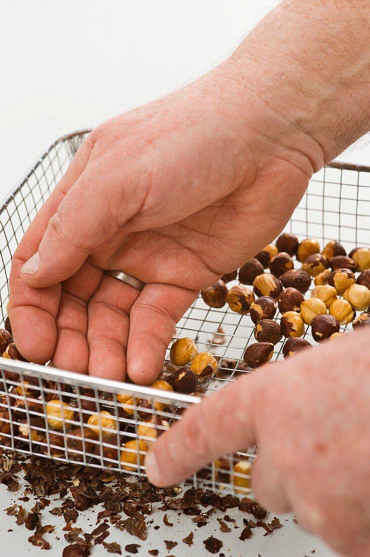 Hazelnuts being shelled in a wire basket
