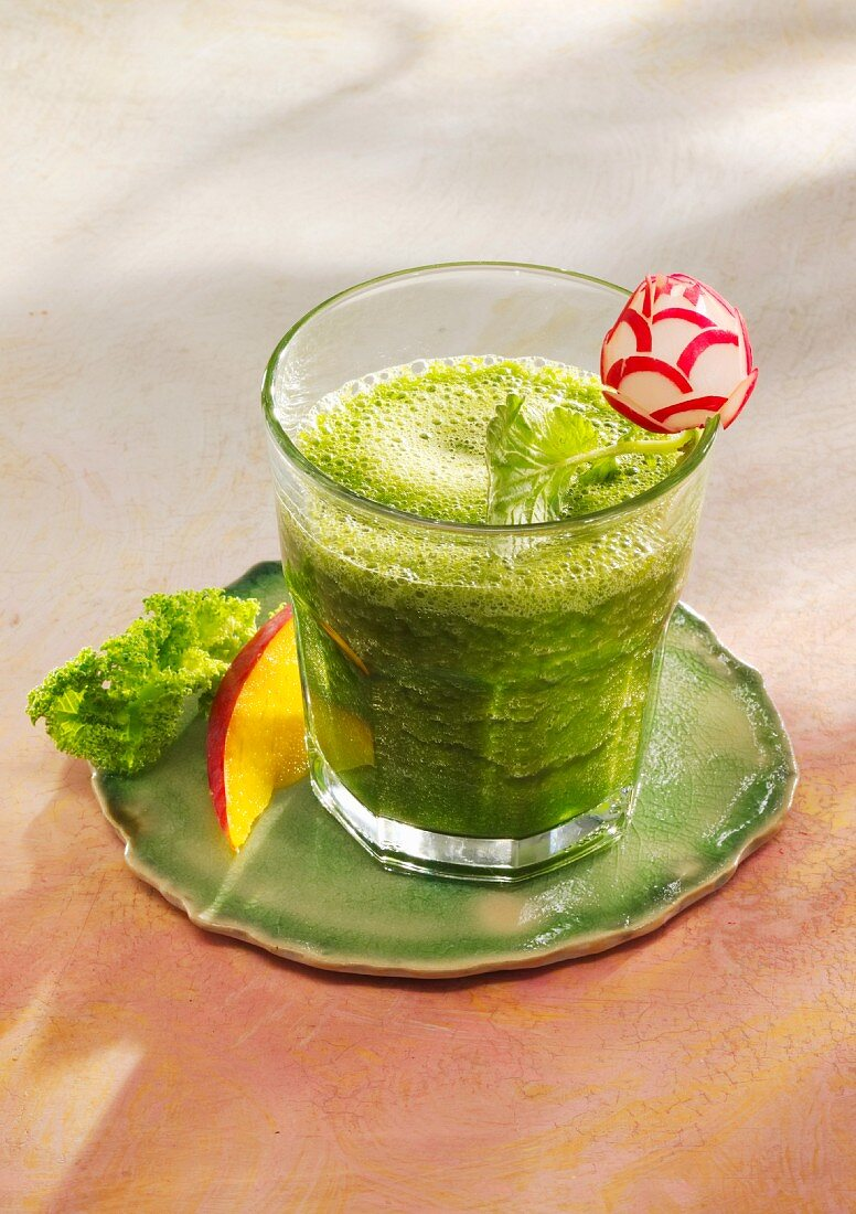 A mango and kale smoothie with chlorella and coconut water