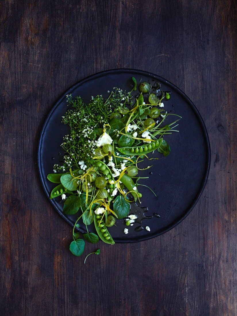 A pea salad with gooseberries and feta cheese