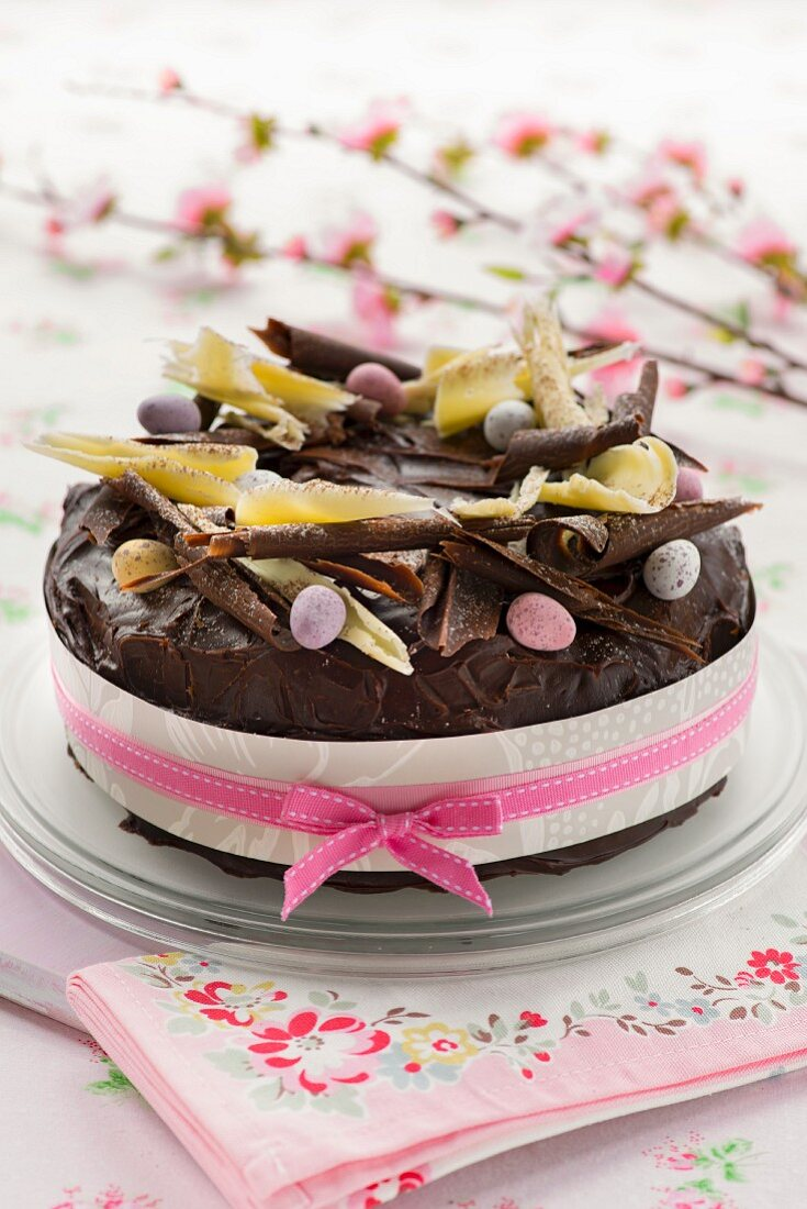 An Easter cake with chocolate glaze and sugared eggs