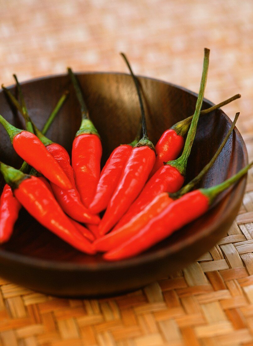 Red chilli peppers in a wooden bowl