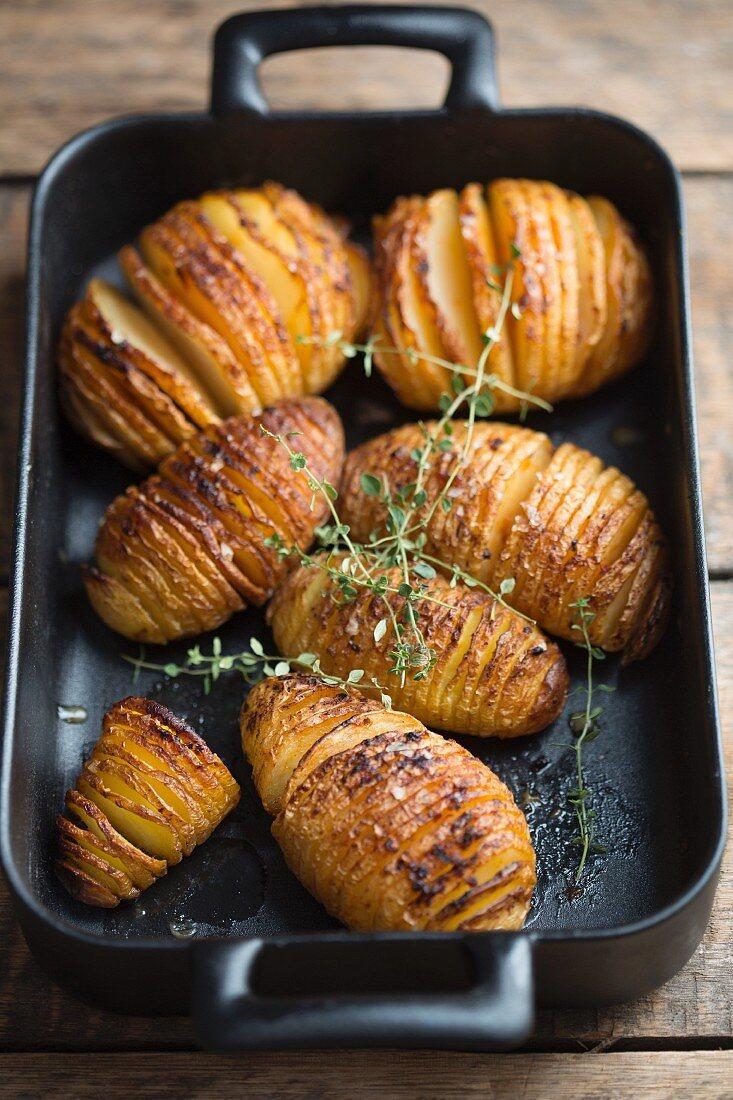 Hasselback potatoes in a roasting tin