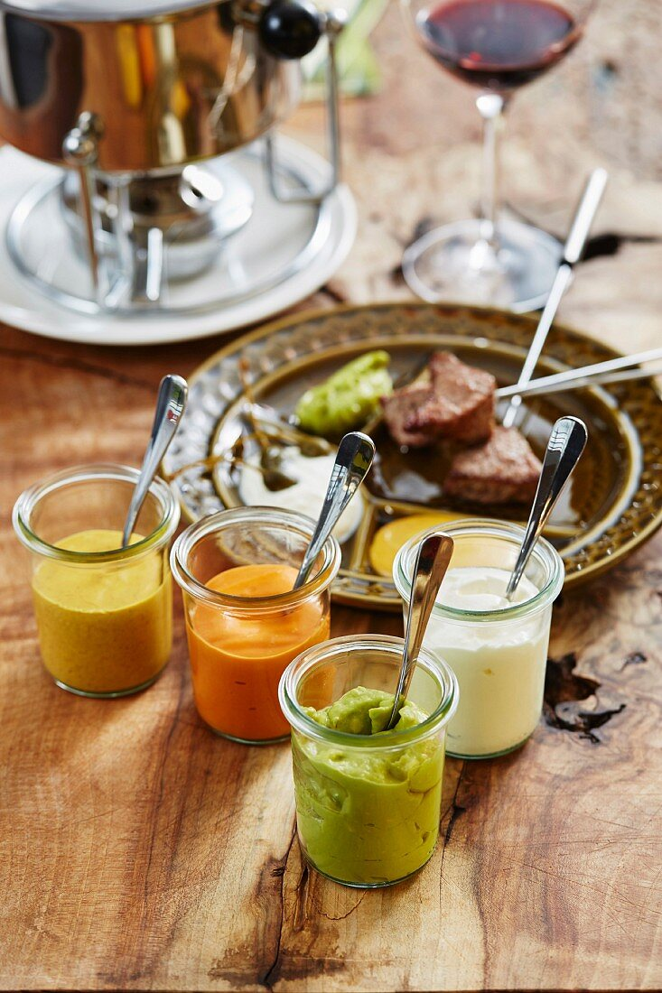 Meat fondue and various sauces