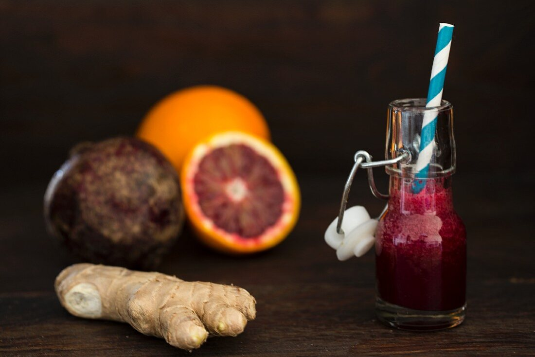 A bottle of beetroot smoothie with ginger, blood oranges and beetroot