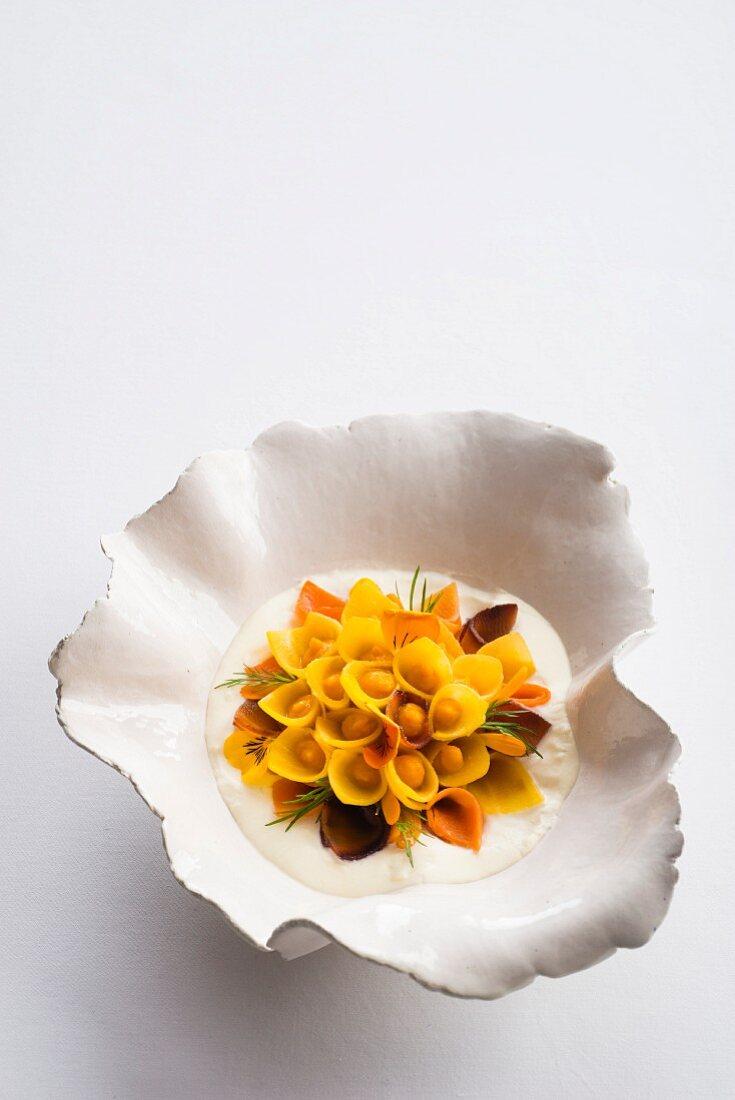 A carrot sunflower in orange cream