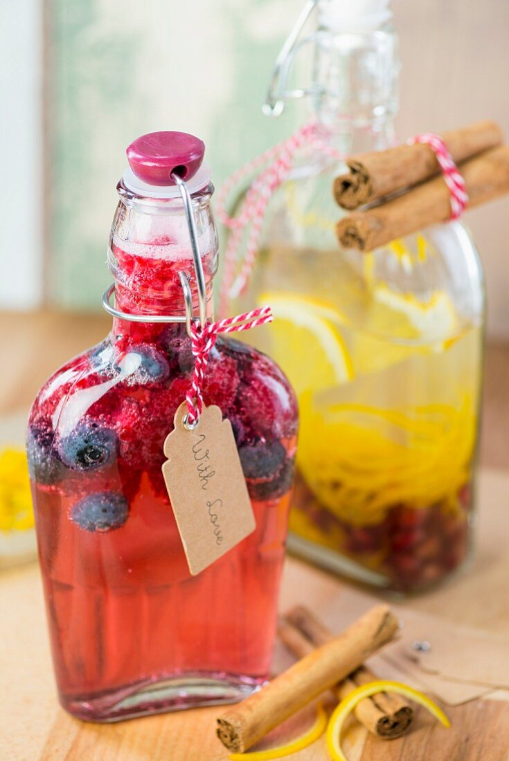 Homemade raspberry gin and orange vodka as gifts