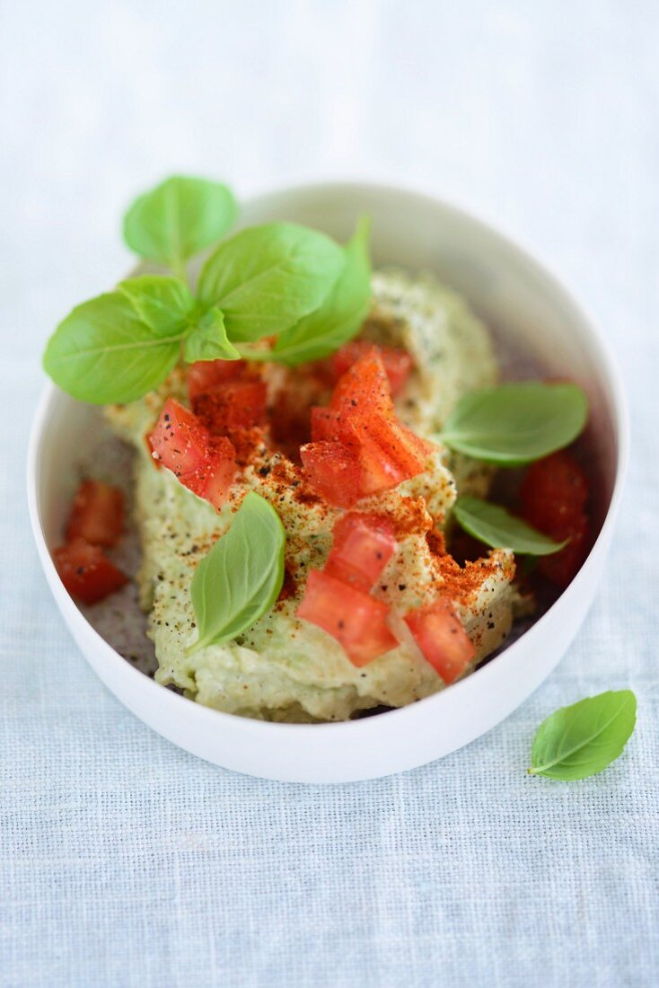 Avocado spread with tomatoes and basil
