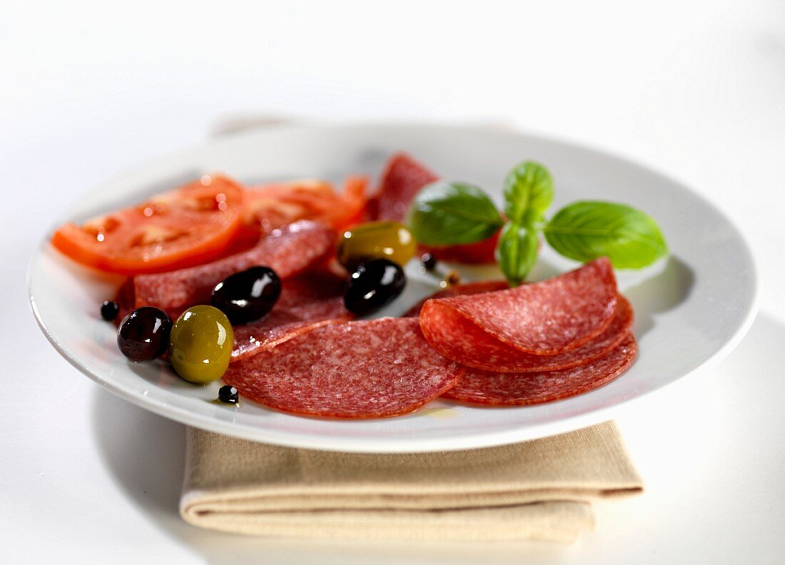 Salami with olives and tomatoes