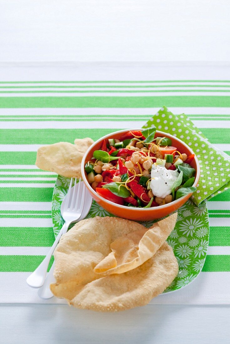 Chickpea salad with peppers and poppadoms