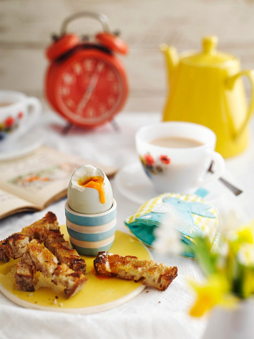 Breakfast with a soft boiled egg and toast soldiers