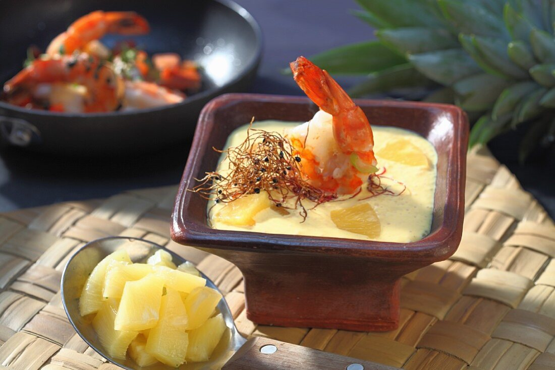 Pineapple and curry soup with prawns