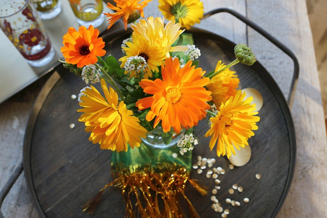 A bouquet of yellow asters on a tray