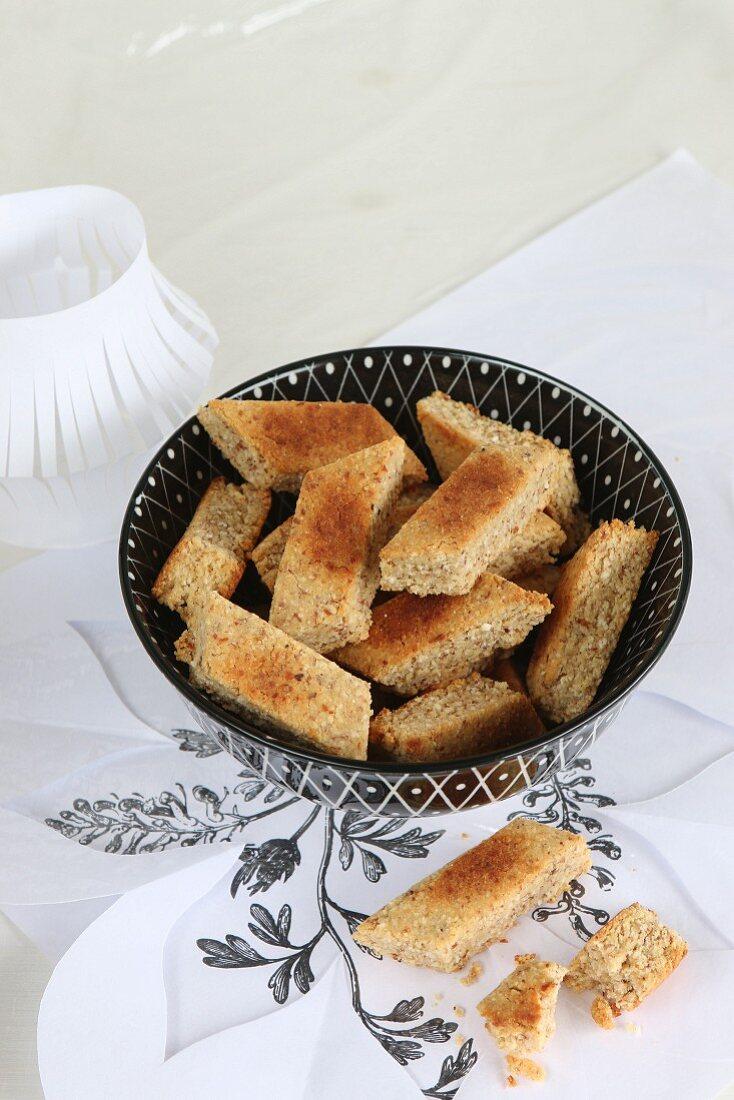 Gluten-free almond cakes with cinnamon cut into diamond shapes