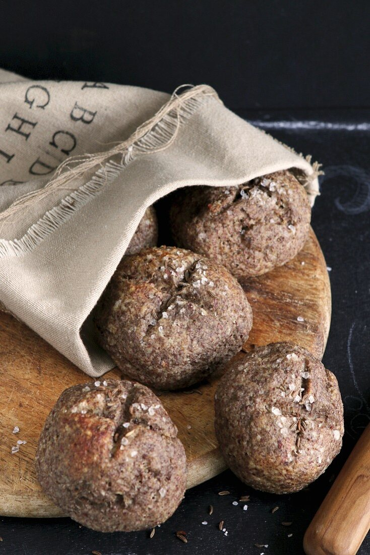 Gluten-free rolls made from flaxseed flower and caraway in a linen bag