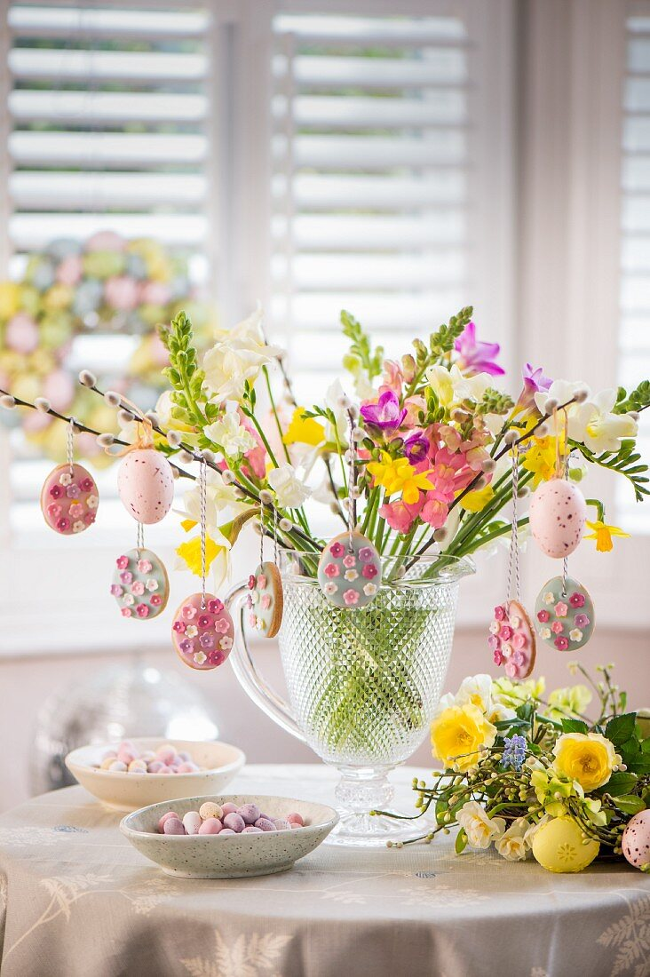 Easter biscuits hanging from spring twigs