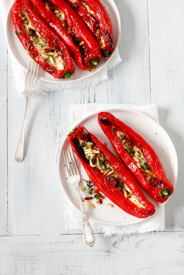 Stuff pointed peppers filled with mozzarella, dried tomatoes and pine nuts