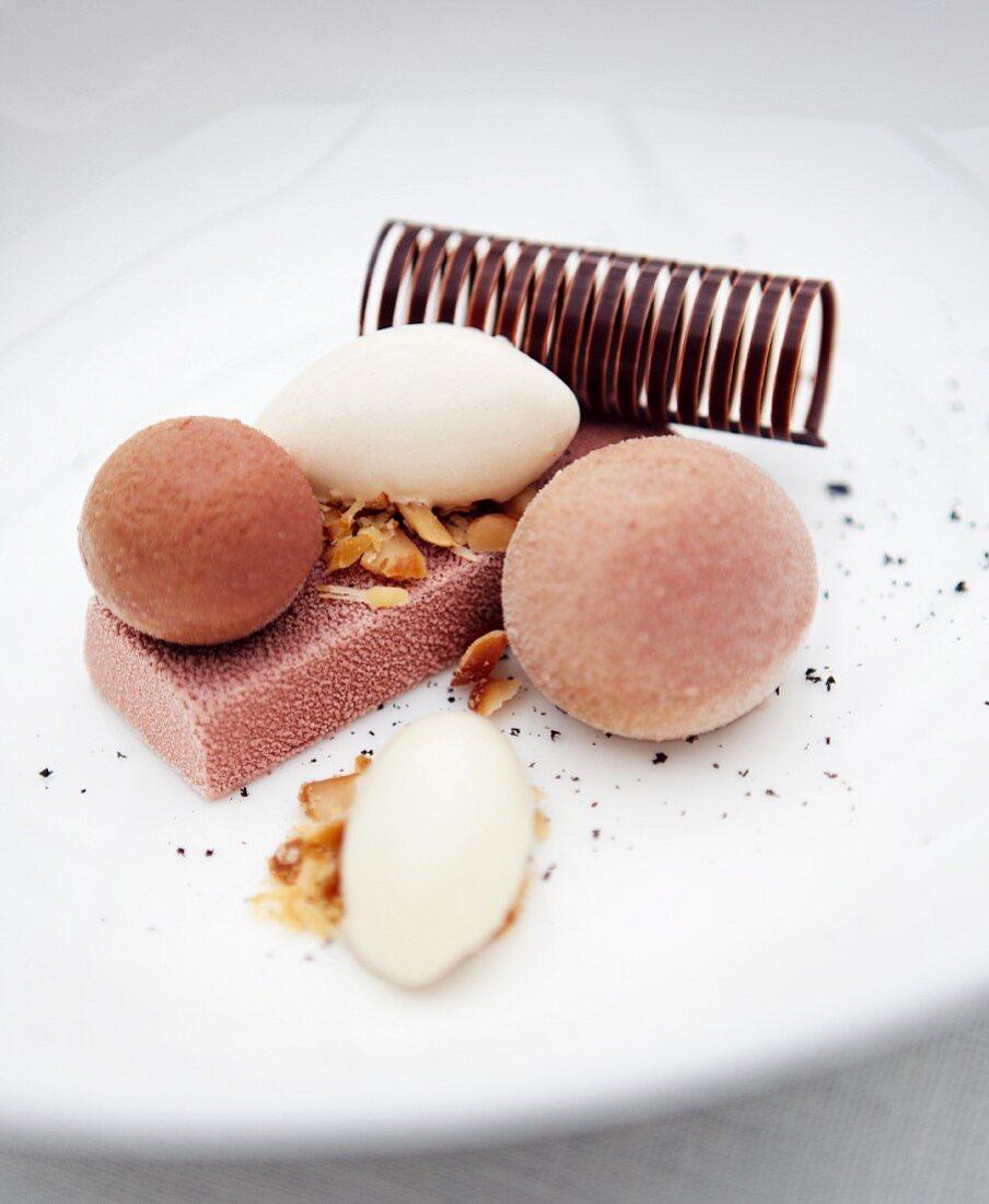 Liquorice ice cream with caramelised macadamia nuts, chocolate cream and caramel mousse