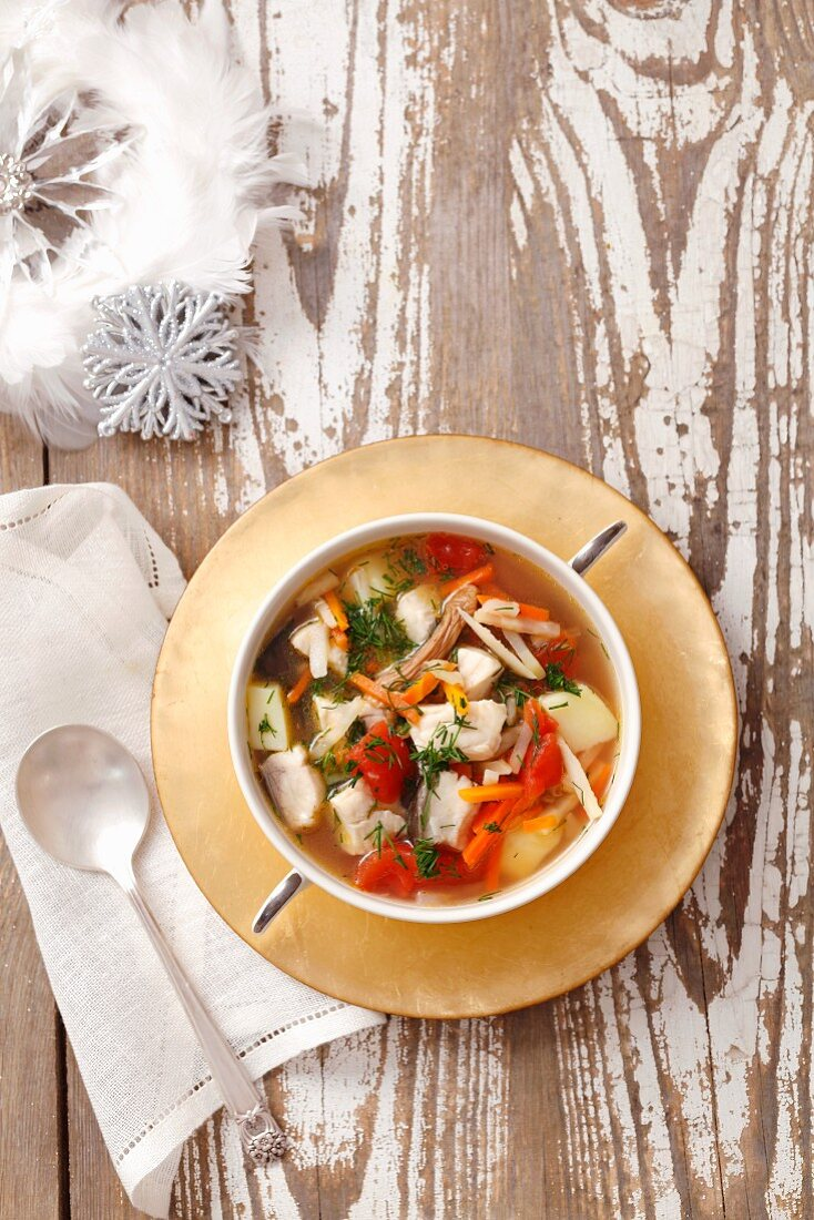 Fish soup with carp, tomatoes and potatoes for Christmas