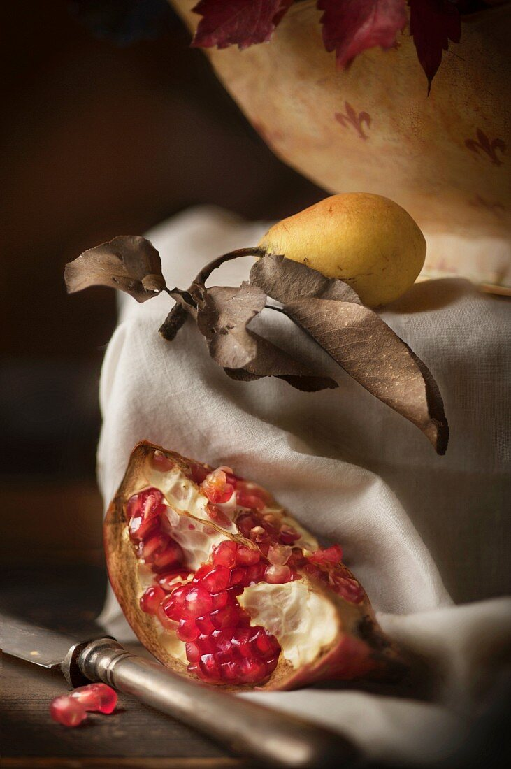 A piece of pomegranate and a pear