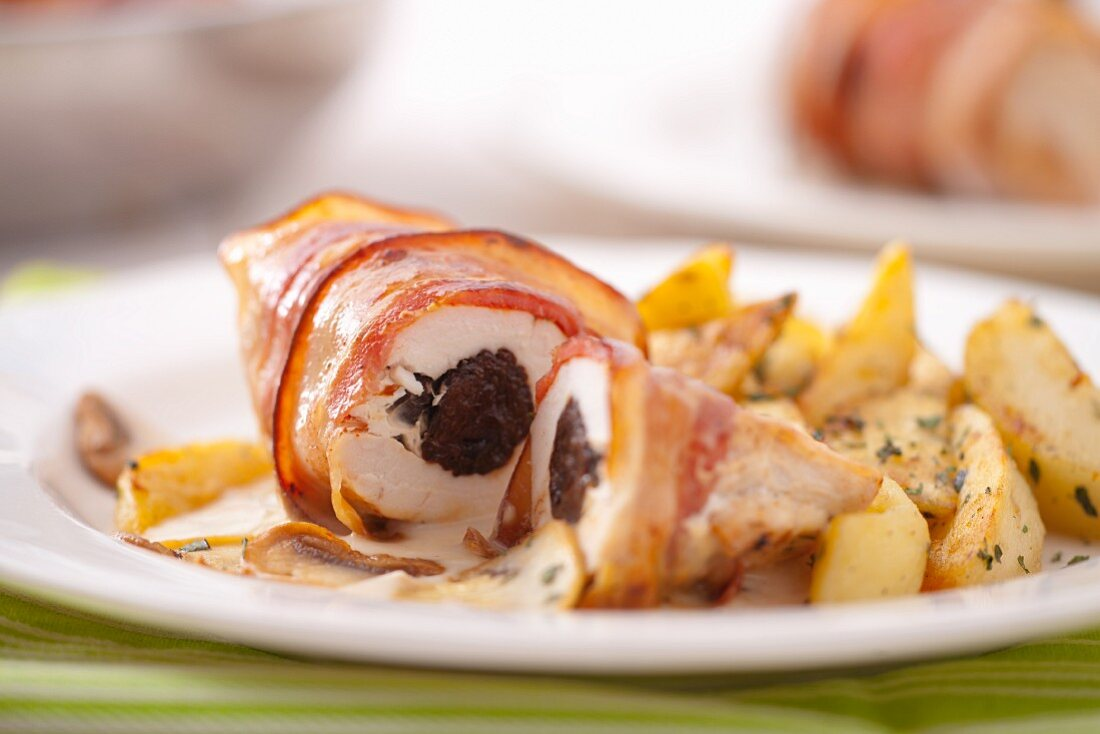 Chicken breast wrapped in bacon filled with plums