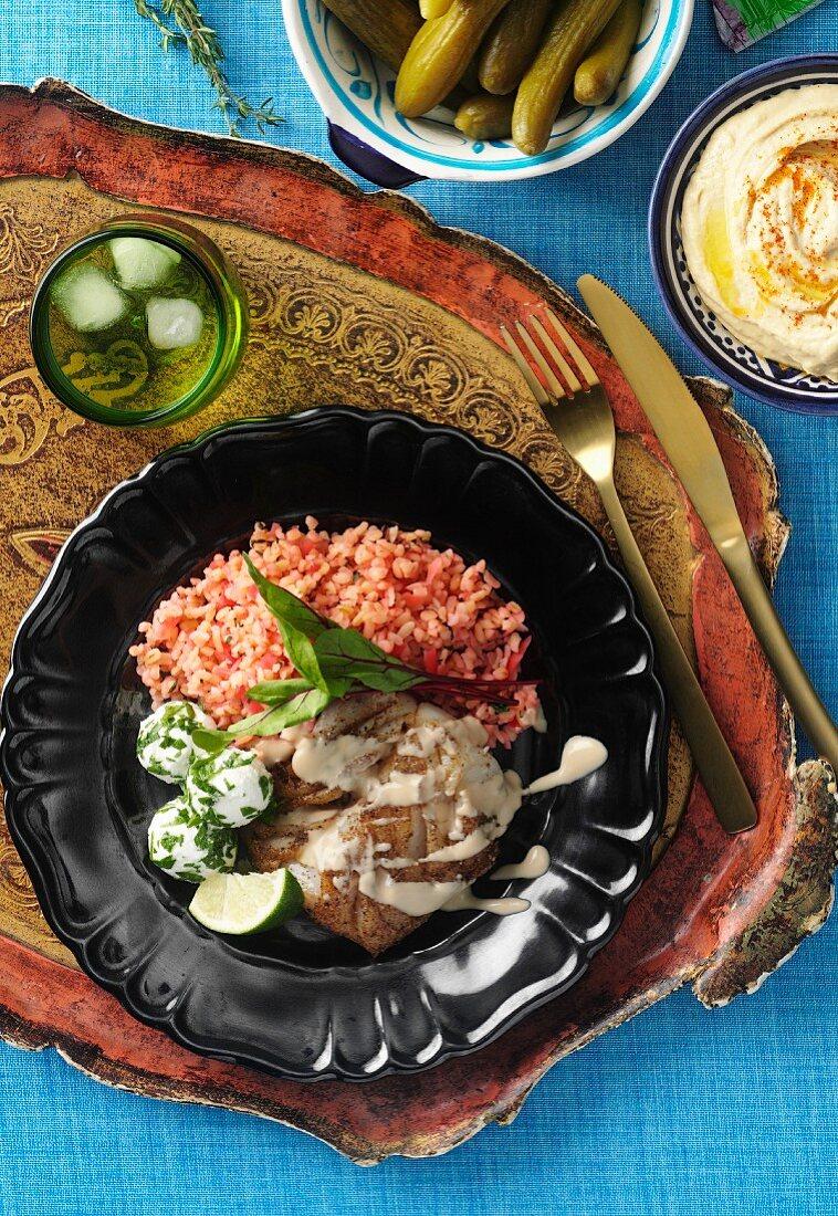 Spicy fish with tahini and tomato rice (Lebanon)