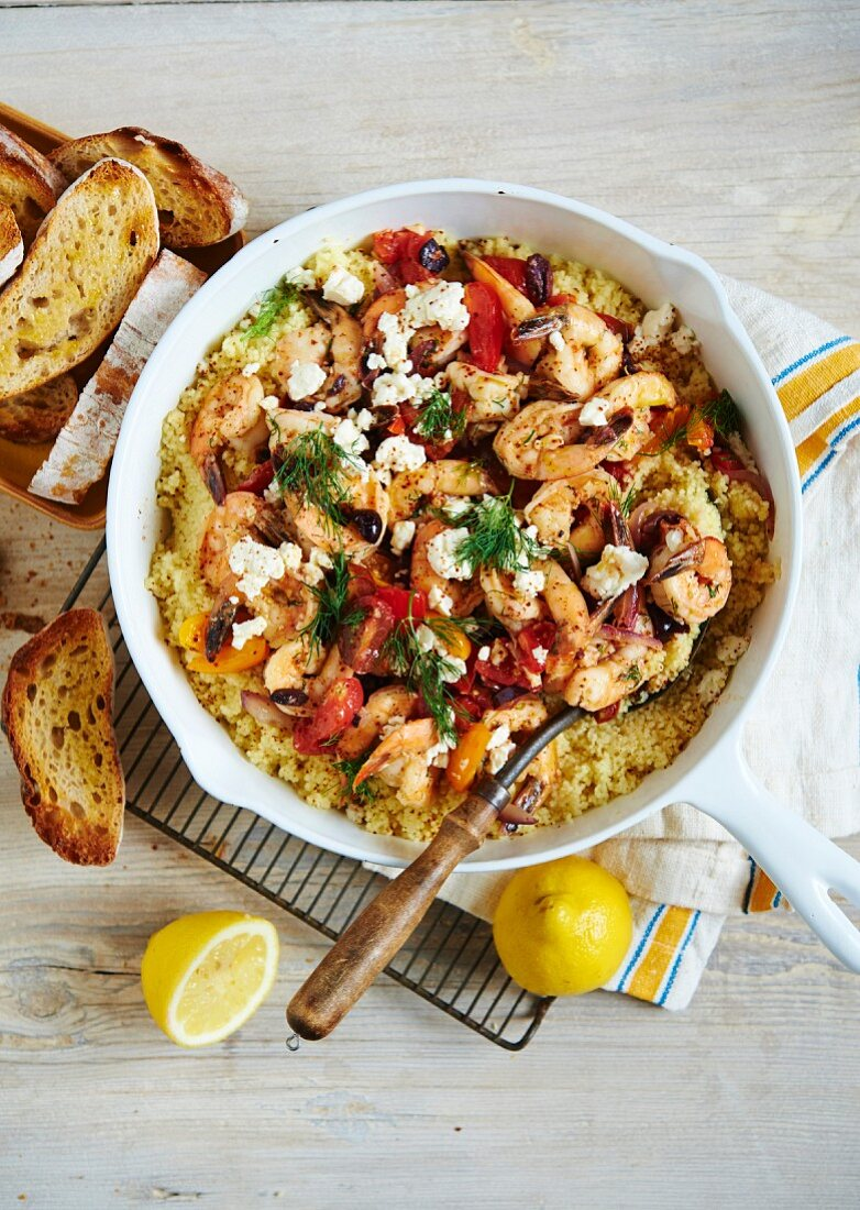 Prawn Saganaki with tomatoes, feta cheese and couscous (Greece)