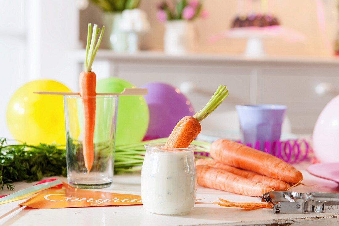 A fresh carrot in a dip