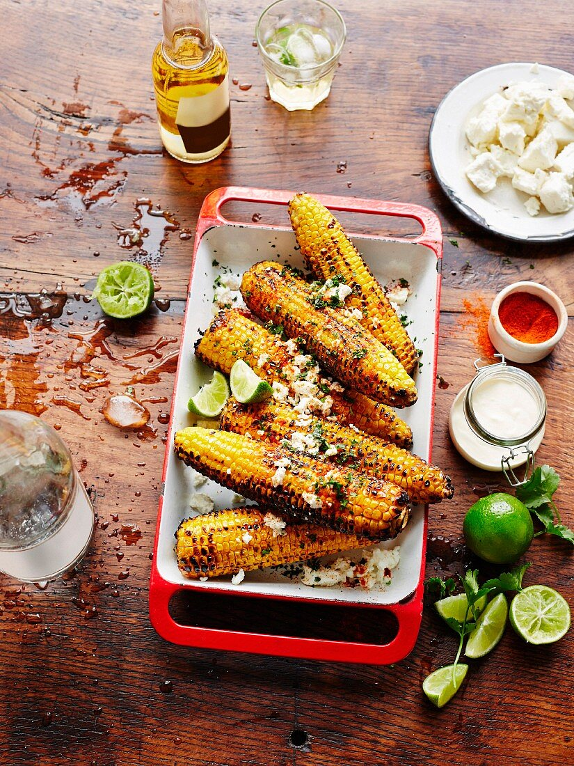 Elotes, grilled Mexican corncobs with feta cheese