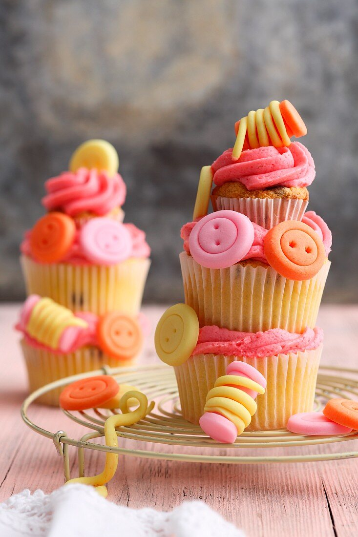 A stacking of sewing-themed cupcakes