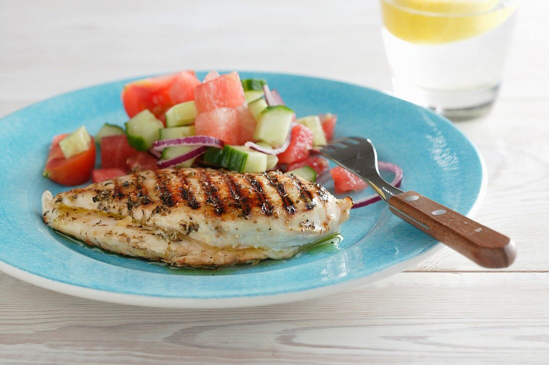 Grilled chicken breast with a watermelon and cucumber salad