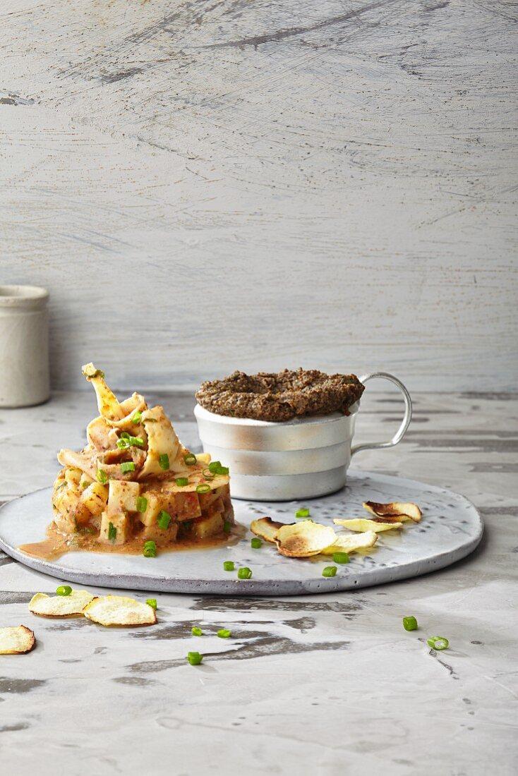 Mushroom and potato soufflé with hempseed flour, parsley root and a hazelnut oil marinade