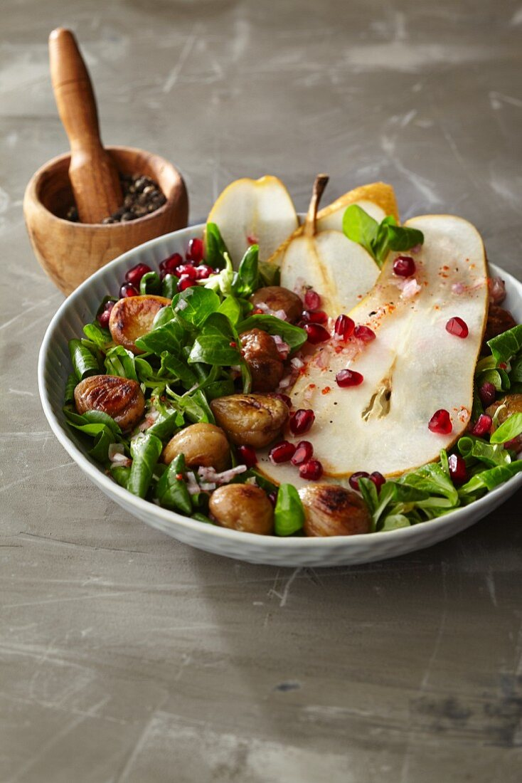 Lambs lettuce in sumac vinaigrette with pomegranate seeds, grated pear and roasted chestnuts