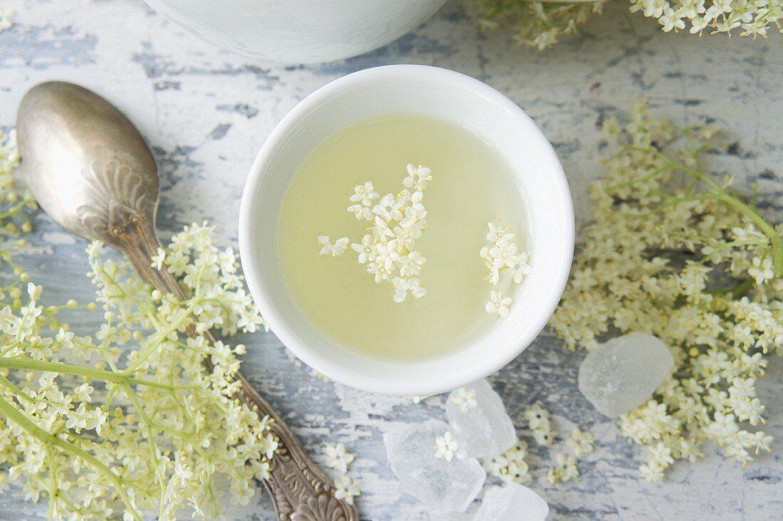 Elderflower tea in a white tea bowl