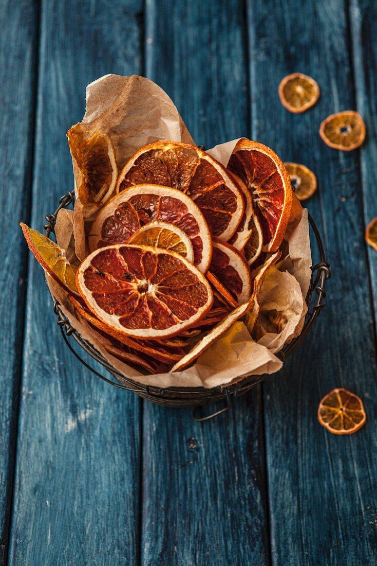 Dried orange slices in a wire basket