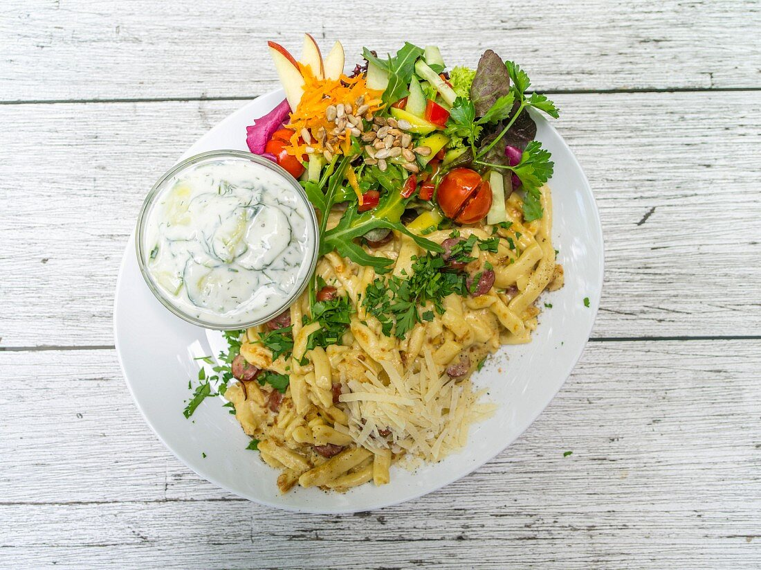 Pasta with ham and cream sauce and a side salad