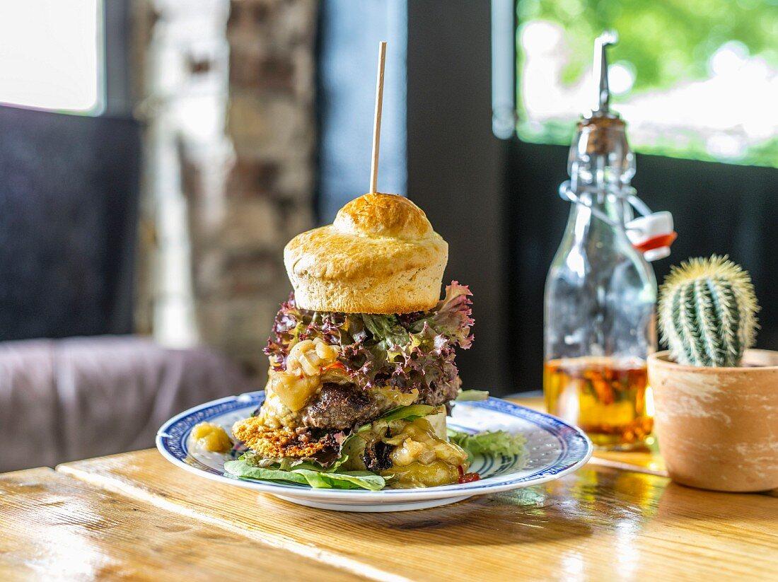 A pop-over burger in a restaurant