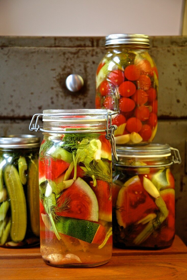 Jars of pickled vegetables (watermelon, cucumber, celery, tomatoes, garlic, dill) from Russia