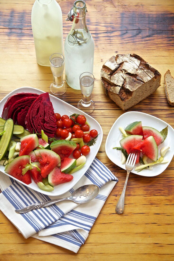 Vodka, bread and pickled vegetables from Russia (red cabbage, watermelon, cucumber, celery, tomatoes, garlic, dill)