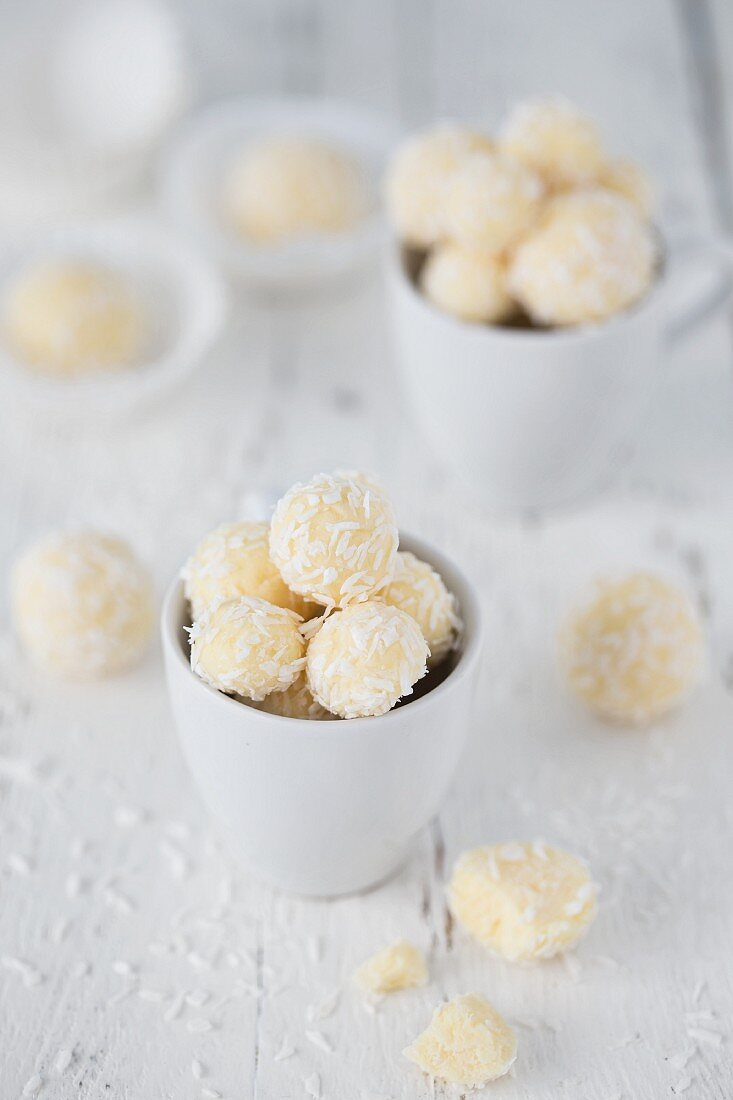 Coconut truffles in a white cup