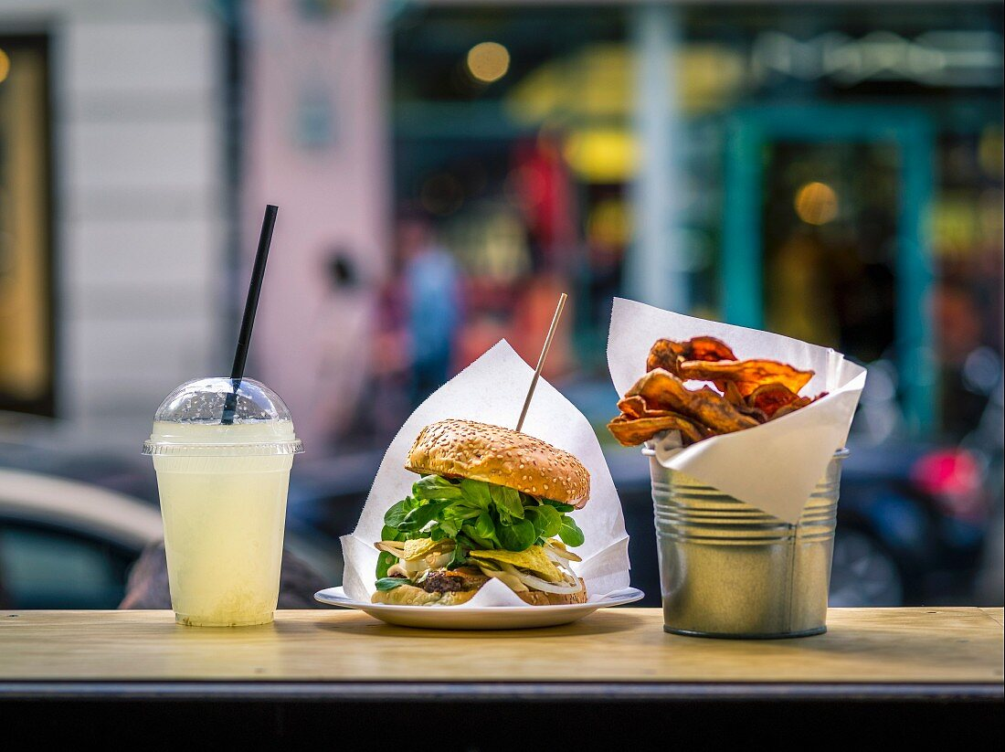 A burglar, lemonade and chips in a fast food restaurant