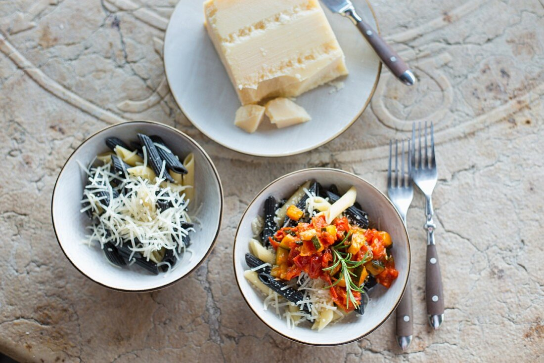 Penne pasta with Parmesan cheese, and penne paste with vegetable sauce and Parmesan cheese (Italy)