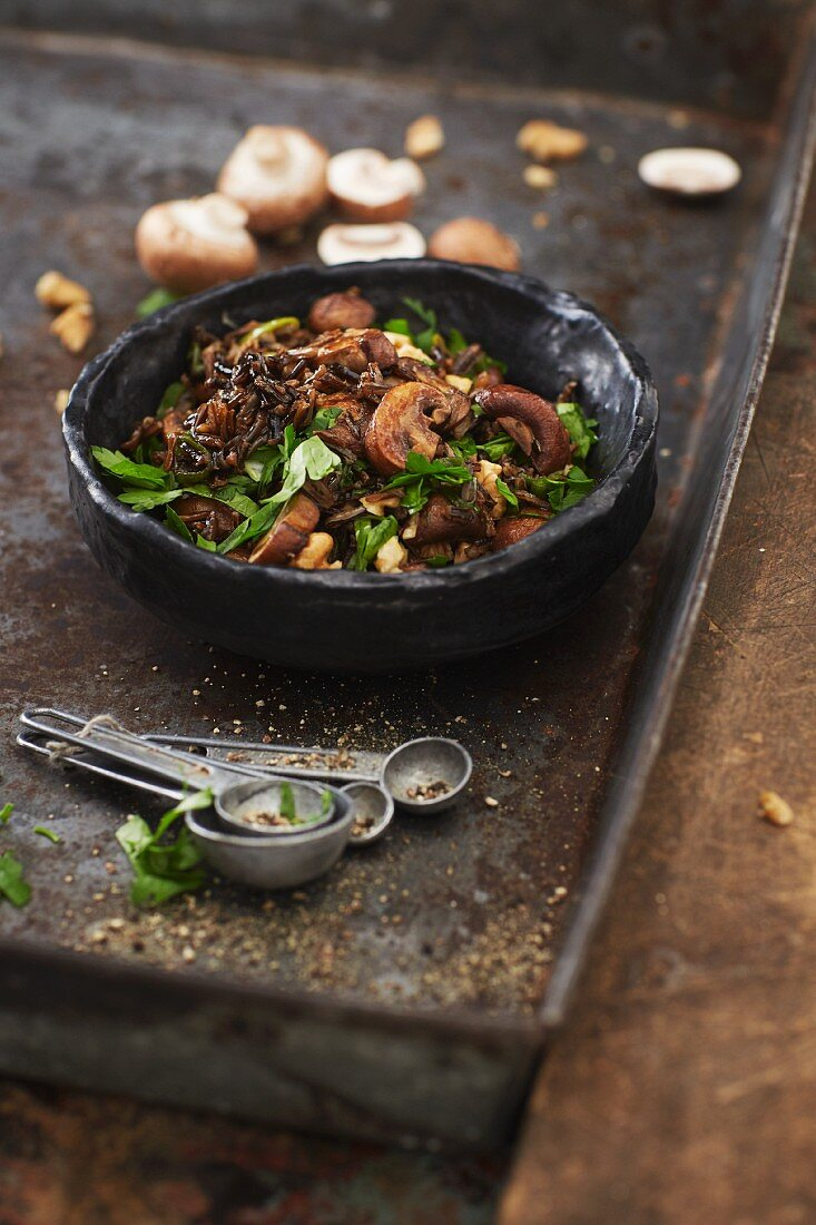 Mushroom salad with black rice and a walnut dressing