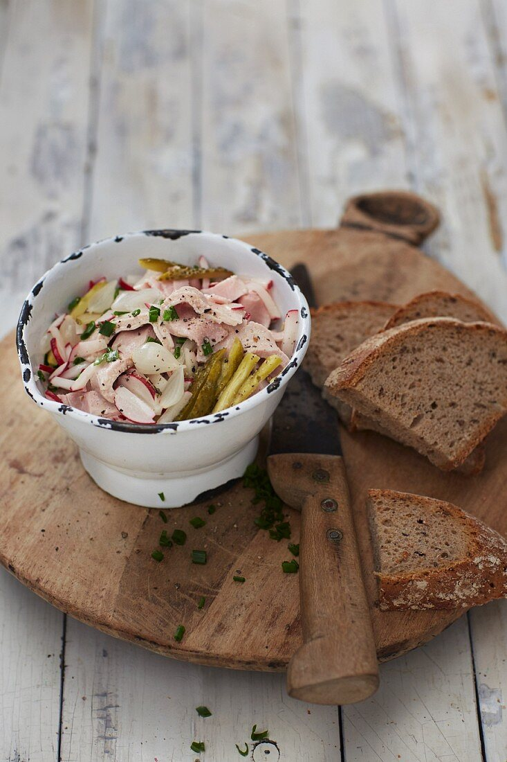 Meat salad with gherkins, vinegar and oil