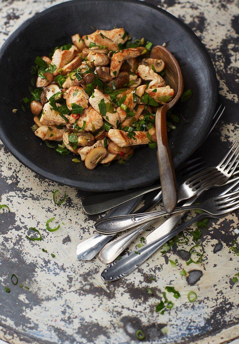 Mushroom salad with fried turkey breast strips