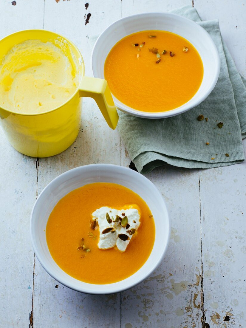 Velvety carrot soup with lemon cream and pumpkin seeds
