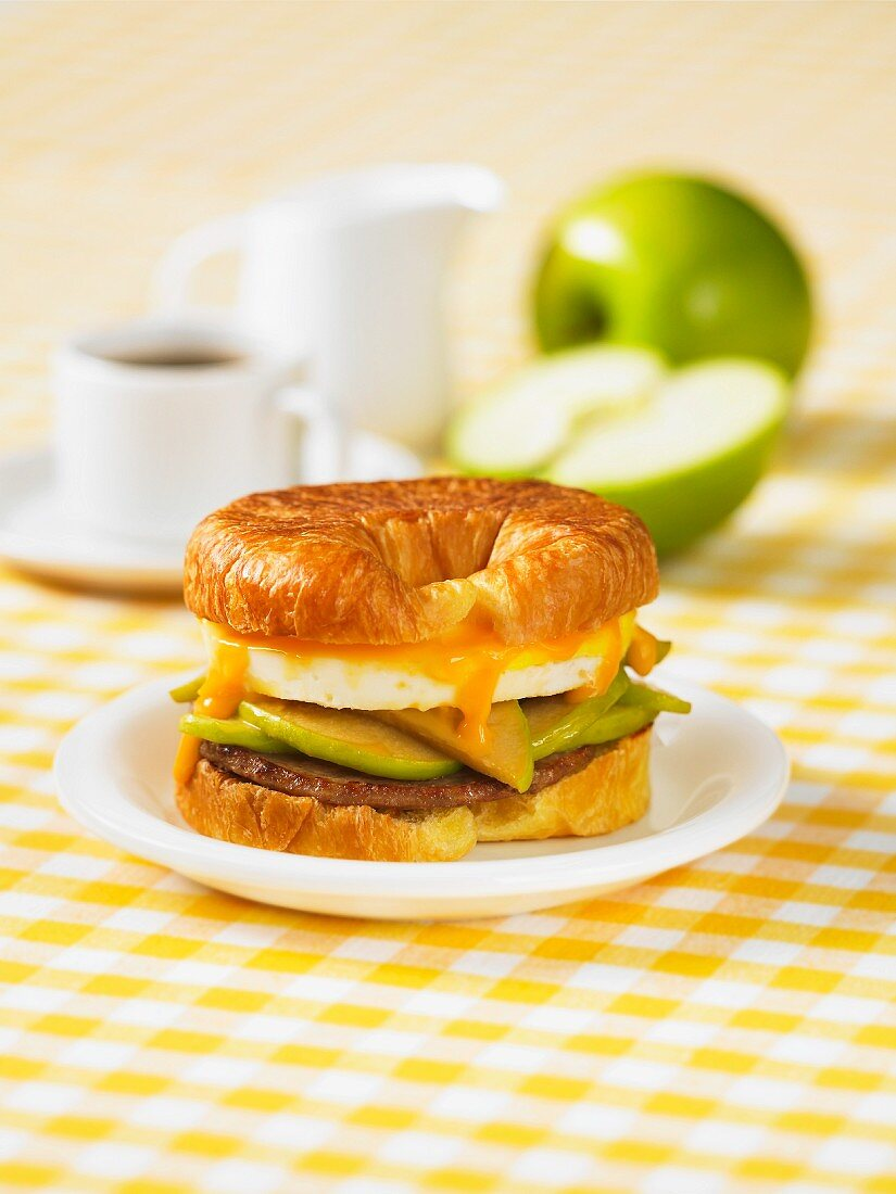 A croissant with apple, bacon and Cheddar cheese