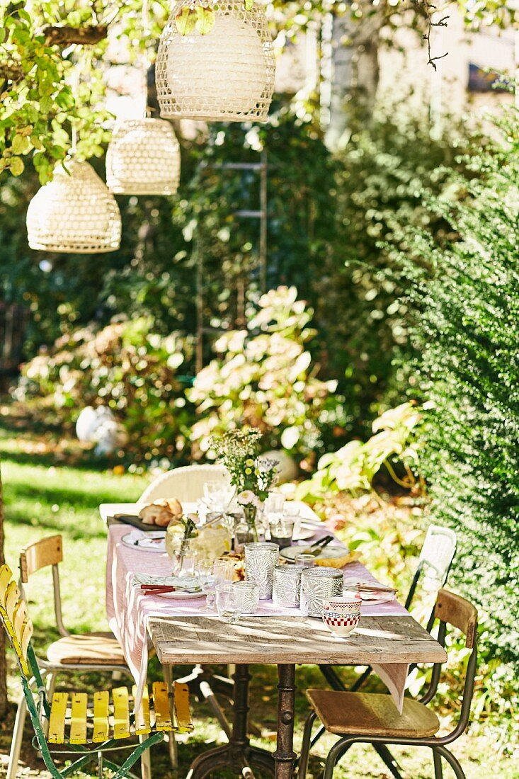 A table decorated with lanterns for a garden party