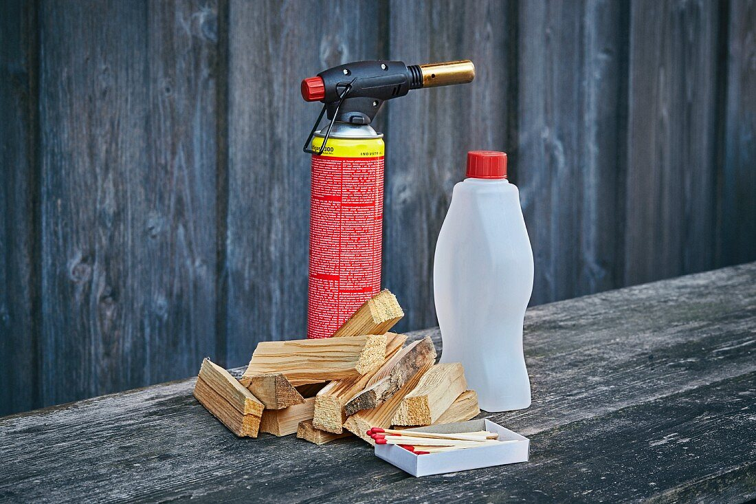 Chunks of wood, a fire lighter and lighting fluid