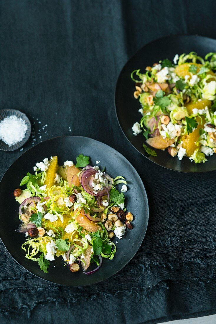 A fresh, citrus Brussels sprout salad with a nut dressing